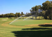 Watering golf courses. — Stock Photo