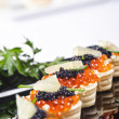 Snacks with salmon roe - Stock Photo