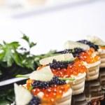 Snacks with salmon roe — Stock Photo #5717635
