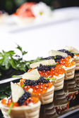 Snacks with salmon roe — Stock Photo