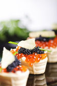 Snacks with salmon roe — Stock Photo