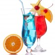 Two tropical cocktails and orange — Stock Photo