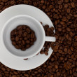 Coffee cup with beans — Stock Photo #5746401