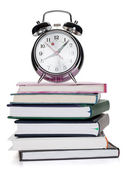 Alarm clock on notepads and books — Stock Photo