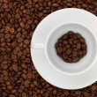 Coffee cup with beans — Stock Photo #5806455