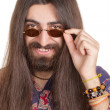 Smiling long-haired hippie man in a glasses - Stockfoto