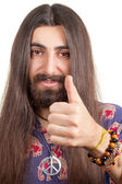Friendly hippie with long hair making agree sign — Stock Photo