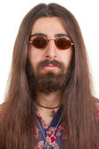 Long-haired hippie man in a glasses — Stock Photo