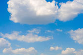 Beautiful white clouds on a blue sky — Stock Photo