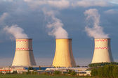 Power plant cooling towers against blue sky — Stock Photo