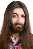 Long-haired smiling hippie man — Stock Photo