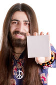 Long-haired hippy man holding blank paper card — Stockfoto