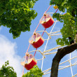 Ferris wheel carousel against blue sky — Stockfoto #6638312