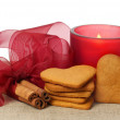Christmas gingerbread, cinnamon and candle — Stock Photo