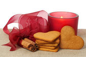 Christmas gingerbread, cinnamon and candle — Stok fotoğraf