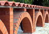 Fence of bricks — Stock Photo
