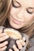 Beautiful woman holding cup of coffee — Stock Photo