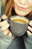 Woman holding cup of coffee — Stock Photo