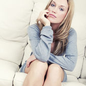 Beautiful woman relaxing at home — Stock Photo