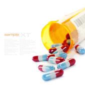 Comprimidos que derramam fora de frasco de comprimidos isolado no branco (com texto da amostra) — Foto Stock