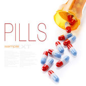 Pills spilling out of pill bottle — Stock fotografie