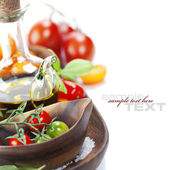 Fresh tomatoes and olive oil — Stock Photo