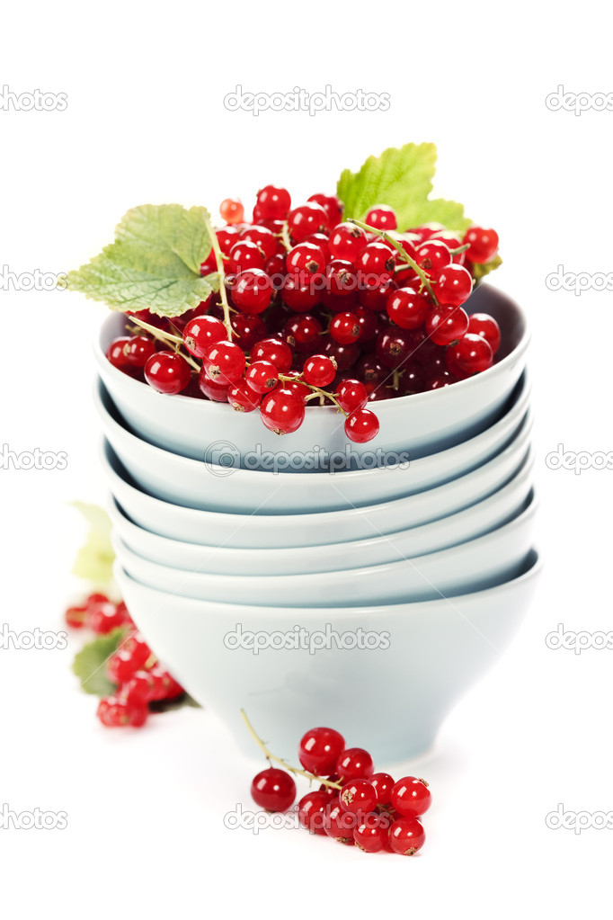 Stack of bowls and ripe red currant berries over white  Stock Photo #6638382