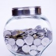 Overflowed bank with coins — Stock Photo