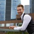 Portrait of a handsome smiling young business man. Outdoor photo. — Stock Photo