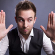 Young businessman holds on his hands empty space. - Stock Photo