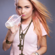 Young teenager girl drinking a coffee. Studio shoot on gray. - Foto Stock
