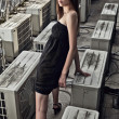 Young romantic model on a skyscraper roof. - Stock Photo