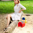 Fashion blond girl In a sandbox. Photo.  — Stock Photo