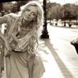 Beautiful blond model outdoor. Street fashion Sepia photo. — Stock Photo