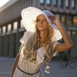 Portrait of a beautiful model in white retro hat. Street fashion photo. — Stock Photo #6524283