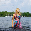Beautiful blond model standing on water. Outdoor conceptual photo. — Stock Photo #6524297
