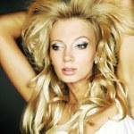 Amazing portrait of beautiful young blond woman. Close-up face studio photo — Stock Photo #6524477