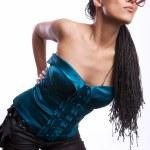 Beautiful fashion mulatto woman wearing sunglasses over a white background. — Stock Photo