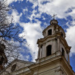 Towers of an old catholic church reaching in to the sky  — Stock Photo