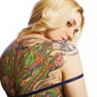 Sexy woman with tattoo on her back — Stock Photo