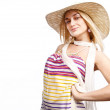 Lovely blond smiling girl on hat. Studio portrait. — Stock Photo #6524877