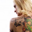 Portrait of sexy woman with tattoo on her back — Stock Photo #6524889
