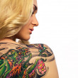 Portrait of sexy woman with tattoo on her back — Stock Photo #6524896