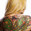 Sexy woman with tattoo on her back — Stock Photo #6524904