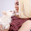 Blond beauty with her little dog. — Stock Photo
