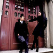 Stock Photo: Pair young near an input in an old building. Evening outdoor shoot.
