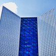 Highrise glass building with sky and clouds reflection — Stock Photo