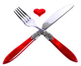 Red plug and knife near heart symbol — Stock Photo