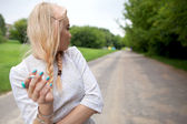 Woman with cigarette in summer scenery — Stock Photo