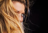 Photo of beautiful woman which hide face on heirs. Close-up blond hairs. — Stock Photo